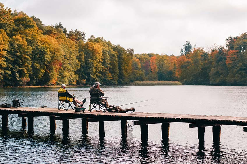 two men fishing on a dock in charlottesville