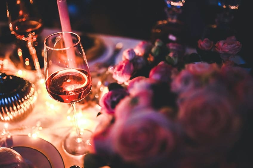 wine and roses on table