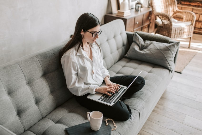 woman working from home on couch